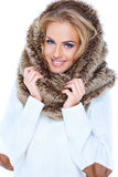 Attractive blond woman wearing fur hood. And smiling Stock Photography