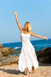 Attractive blond woman in white dress. Stock Photo