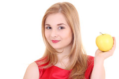 Attractive blond with yellow apple Stock Image