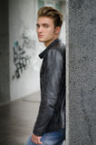 Attractive blond young man in city environment Royalty Free Stock Images