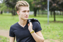 Attractive blond young man outdoors in a park Royalty Free Stock Photography