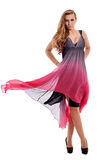 Attractive blond young woman in pink dress isolated Stock Image