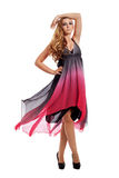 Attractive blond young woman in pink dress isolated Stock Photography
