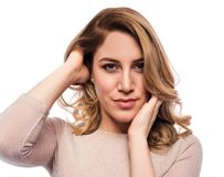 Attractive blond young woman. Portrait of a beautiful woman on a white background. Royalty Free Stock Photo