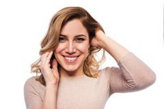 Attractive blond young woman. Portrait of a beautiful woman on a white background. Stock Images