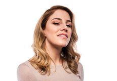 Attractive blond young woman. Portrait of a beautiful woman on a white background. Stock Image