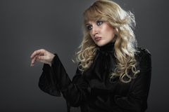 Attractive blonde. Portrait girl with beautiful hair Royalty Free Stock Photos