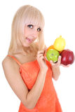 Attractive blonde with apples, lemon and orange Stock Images
