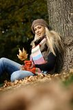 Attractive blonde in autumn park Stock Photography
