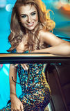 Attractive blonde beauty in an elegant car Royalty Free Stock Images