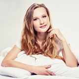 Attractive blonde in bed Royalty Free Stock Images