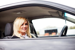 Attractive blonde behind the wheel Stock Photography