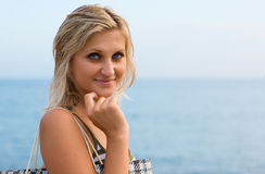 Attractive blonde in the blue sea stock images