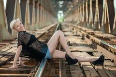 Attractive blonde on the bridge Stock Image