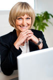 Attractive blonde business executive posing Stock Image