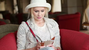 Attractive blonde business woman using smart phone