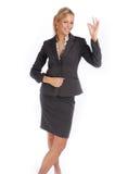 Attractive blonde businesswoman in black suit Stock Images