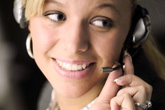 Attractive blonde businesswoman with headphone Stock Images