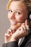 Attractive blonde businesswoman with headphone Royalty Free Stock Photography