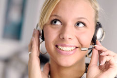 Attractive blonde businesswoman with headphone Stock Photography