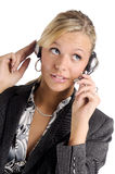 Attractive blonde businesswoman with headphone Royalty Free Stock Images