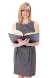 Attractive blonde businesswoman holds black diary Stock Photos
