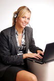 Attractive blonde businesswoman with notebook Stock Photo