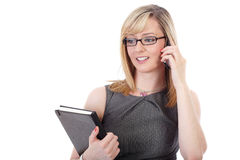 Attractive blonde businesswoman talks over phone Stock Image