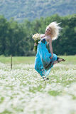 Attractive blonde in chamomile field Stock Photos