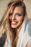 attractive blonde cheerful girl in white silk scarf looking royalty free stock photos