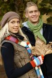 Attractive blonde couple at autumn smiling Stock Photos