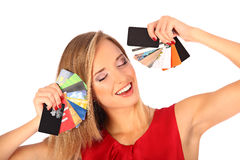 Attractive blonde with credit card in hand Royalty Free Stock Photography