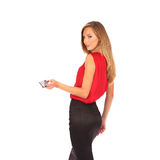 Attractive blonde with credit card in hand Royalty Free Stock Image