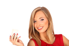 Attractive blonde with credit card in hand Royalty Free Stock Photo