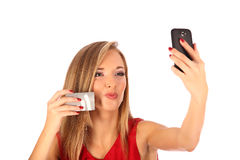 Attractive blonde with credit card in hand Stock Image