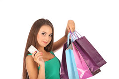 Attractive blonde with credit card in hand Stock Photos
