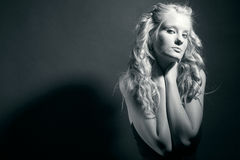Attractive blonde with curly hair. Stock Photography