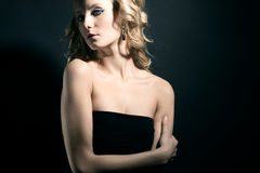 Attractive blonde with curly hair. Royalty Free Stock Image