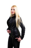 Attractive blonde dressed in black. With her hands around the body. White background Royalty Free Stock Images