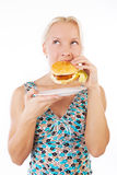 Attractive blonde eating burger Royalty Free Stock Photo