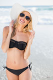 Attractive blonde in elegant black bikini smiling at camera Royalty Free Stock Photos