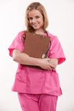 Attractive blonde female caucasian nurse doctor Stock Photos