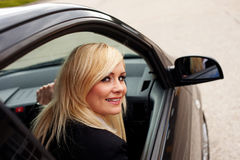 Attractive blonde female driver Royalty Free Stock Images