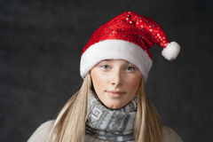 Attractive blonde female santa, christmas season, Stock Image