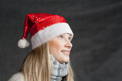 Attractive blonde female santa, christmas season, Royalty Free Stock Photography