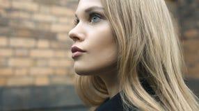 Attractive blonde female on street Stock Photos