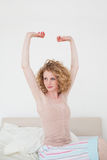 Attractive blonde female stretching in her bedroom Royalty Free Stock Photo