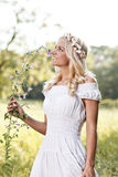 Attractive blonde in the field Royalty Free Stock Images