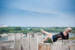 Attractive blonde on the fortress wall Royalty Free Stock Photos