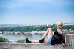 Attractive blonde on the fortress wall Stock Photos